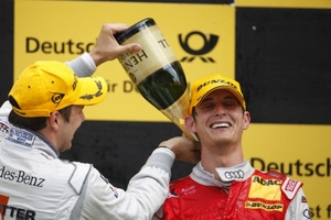 Oliver Jarvis has a little help from Gary Paffett with his celebrations for finishing second in the Zandvoort DTM race in 2009
