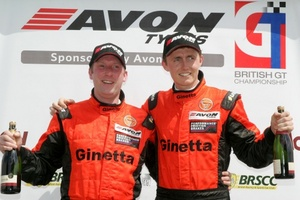 Piers Johnson on the British GT podium with co-driver Oliver Bryant