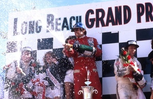 Carlos celebrating victory at Long beach winning the 1978 United States GP West.