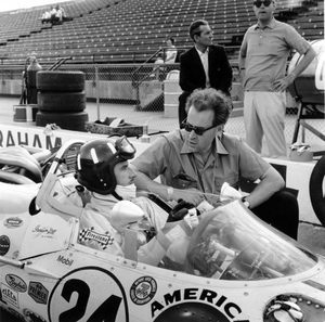 Eric with Graham Hill at the 1966 Indianaolis 500
