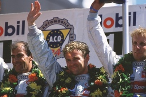Emanuele celebrating with Frank Beila and Ton Kristensen winning the 2000 Le Mans 24h race.