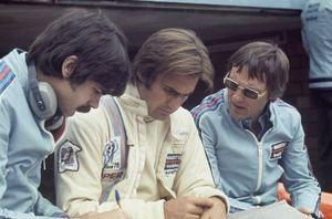 Gordon with Carlos Reutermann and Bernie Ecclestone with the BT44B-Ford at Zolder, 1975