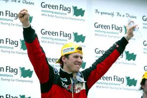 Luke on the podium at Brands Hatch, April 2004 after winning in a VX Racing Vauxhall Astra.