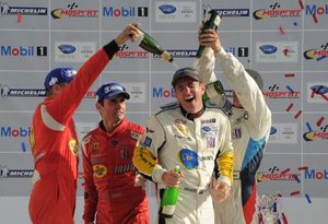 Oliver being showered with Champagne at Bowmanville, July 2011 at GT2 winner